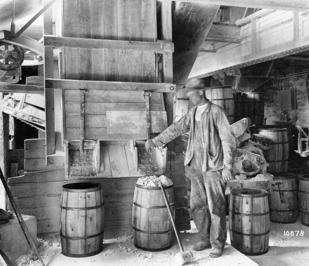 Worker at Carson & Sons in Riverton, manufacturers of Woodburnt Lime, circa 1930.