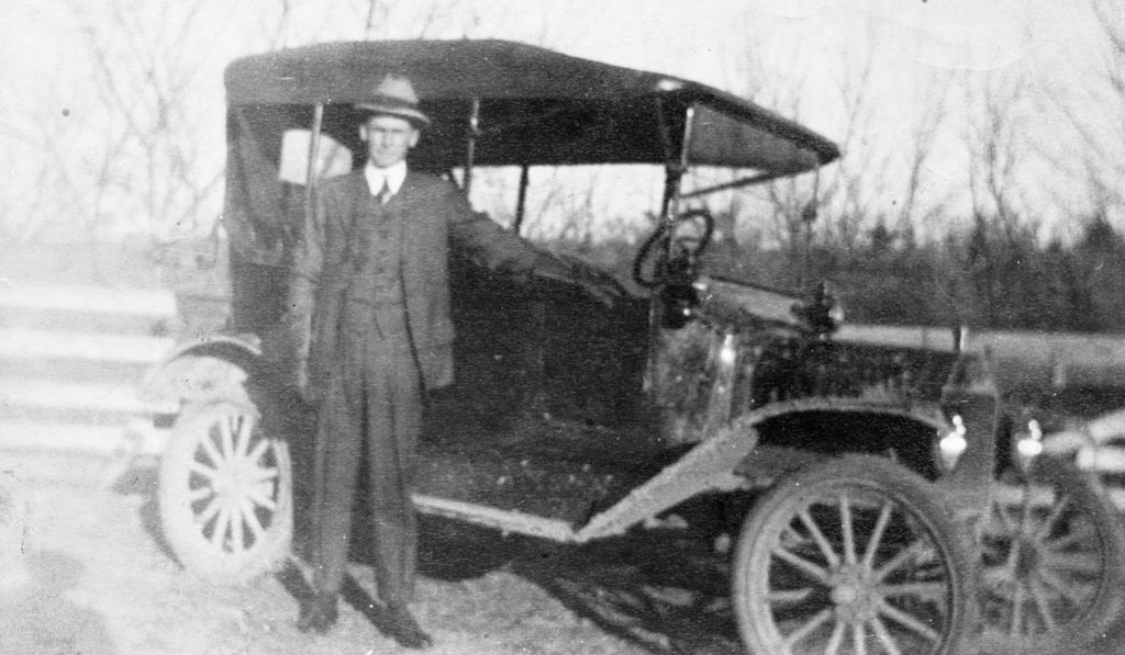 Joseph M. Burke in front of his Ford Model T, circa 1917.  This was the very first car owned in the Fork District of Warren County.