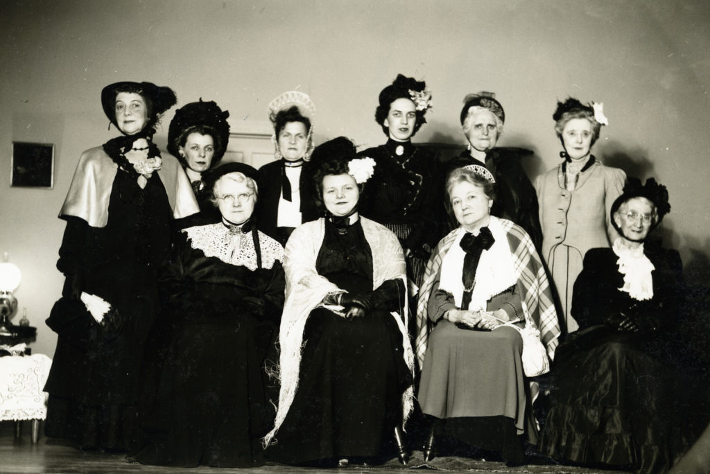 Kings Daughters Group at Parish Hall, Front Royal, circa 1934.  Seated: Mrs. Barr Samsell, Mrs. Donald Albert, Mrs. Marvin Vint, Mrs. Thomas Melton.  Standing: Mrs. C.A. Duke, Mrs. Bessie Smith, Mrs. A.B. Hontz, Helen Bowman, Mrs. Nordine, Mrs. O.R. Bowen.