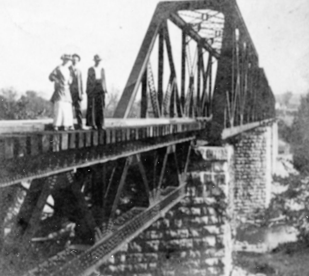 Roberta Mddox, Elizabeth Catherine MacNamera, and Lt. Colonel Thomas MacNamera on the Riverton railroad bridge, circa 1917.