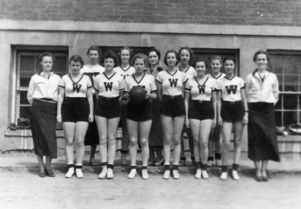 """Warren County High Women's Basketball, 1935-1936.  Front row, from left: Laura Boyd, Gladys Dutson, Barbara Higgins, unidentified, Gladys McFall, Margretta Burke, Elizabeth Boyd, Elizabeth Sonner. Back row: Margaret Pence, """"Bunny"""" Dawning, Laura Trout (coach), Navada Sonner, Jessie Martin."""